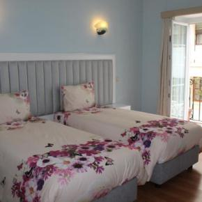 Hostely a ubytovny - Grande Oceano Guest House
