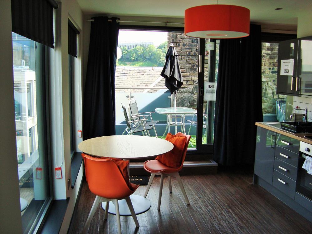 Střešní apartmá s balkónem